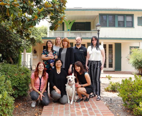 Top row: Camila Fernandez, Maria Johnson Kriechbaum, Liz Jackman, Greg Fletcher, Miranda Maxwell; bottom row: Marta Lopez Viseras, Athena Castro, JJ the dog, and Agnes Tong at the Tyson House