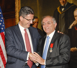 Charles Elachi accepts the rank of knight in the order of the Legion of Honor from François Delattre, Ambassador of France to the United States.