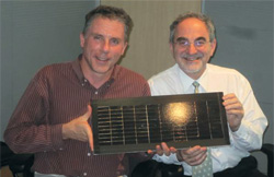 Harry Atwater and Eli Yablonovitch, cofounders | of Alta Devices, hold the world-record–breaking solar cell.