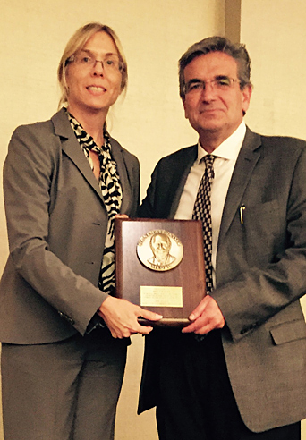Professor Rosakis receiving the Sia Nemat-Nasser Medal