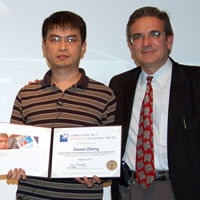Guoan Zheng presented with the $30,000 Lemelson-MIT Caltech Student Prize by Chair Ares Rosakis