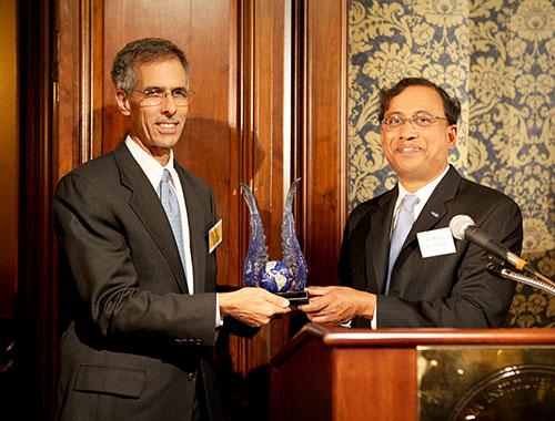 Dr. John Tracy receiving the award from Professor Ravichandran, Chair of Aerospace Historical Society