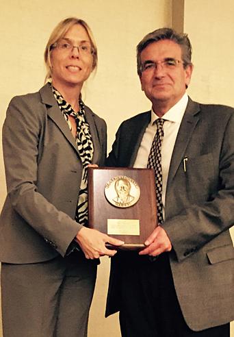 Professor Rosakis receiving the Sia Nemat-Nasser Medal
