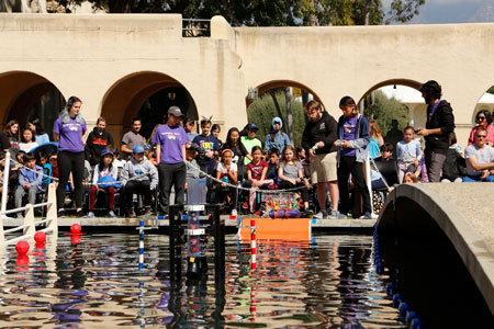 Local elementary school children observe team Misteletein and their robot