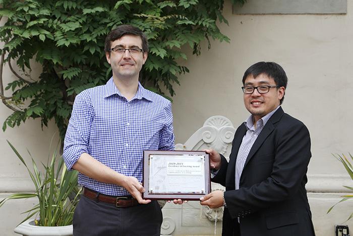 Northrop Grumman representative David Liaw presenting prize to Konstantin Zuev
