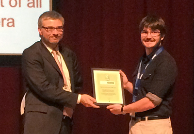 Alexandros Rosakis (on the right) accepting the Fylde Electronics BSSM Best Paper Award in Strain on behalf of all the authors.